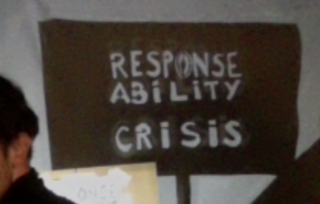 Responsd Ability Crisis, Response Ability Crisis is carved into a black rectangle on a white backdrop. A persons ear is visible at the bottom left, and the face is cropped out of the image.