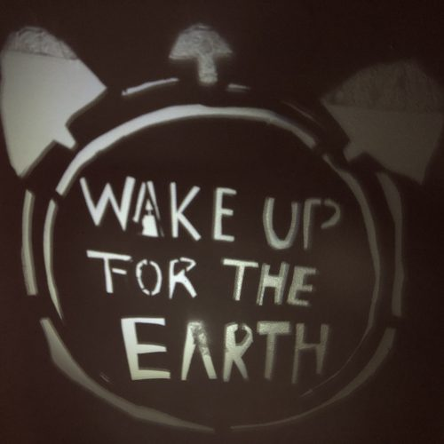 """Wake up for the earth, Shadow sign that says """"WAKE UP FOR THE EARTH"""" inside of an old school alarm clock. ⏰"""